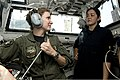 U.S. Navy Lt. Brittny Lambert, left, talks to a midshipman about flight operations in the landing signal officer shack aboard the guided missile destroyer USS William P. Lawrence (DDG 110) July 25, 2013, in 130725-N-ZQ631-267.jpg