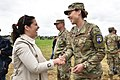 U.S. Rep. Elise Stefanik shakes hands with U.S. Air Force 1st Lt. Michelle Fletcher.jpg