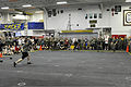 U.S. Sailors and Marine compete in a game of dodge ball during a Moral, Welfare and Recreation fun day in the hangar bay of amphibious assault ship USS Makin Island (LHD 8) in the Philippine Sea Dec. 11, 2011 111211-N-EK905-166.jpg