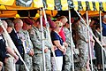 U.S. Soldiers and Gold Star Family members stand and pay respects to fallen U.S. Soldiers, during the 82nd Airborne Division's All American Week memorial ceremony 130523-A-PO583-226.jpg