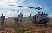 Helicopters played an integral part in the U.S military's land and air operations. Here UH-1Ds airlift members of the 2nd Battalion, 14th Infantry Regiment from the Filhol Rubber Plantation area to a new staging area, in 1966.