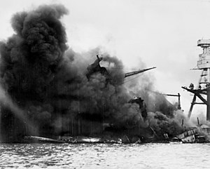 The USS Arizona ablaze after the Japanese attack on Pearl Harbor