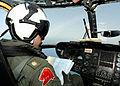 US Navy 020709-N-4374S-011 Pilot checks a navigational chart while flying an MH-53E.jpg