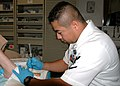 US Navy 041006-N-0184L-010 Hospital Corpsman 3rd Class Carlos Cordova conducts minor surgery on a patient aboard the Naval Hospital Corpus Christi.jpg