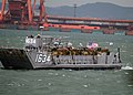 US Navy 060402-N-4124C-094 A Landing Craft Utility (LCU), launched from the amphibious dock landing ship USS Juneau (LPD 10) transports Amphibious Assault Vehicles (AAVs) to the pier in Pohang, Republic of Korea (ROK).jpg