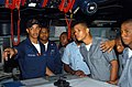 US Navy 060421-N-5307M-777 Gas Turbine System Technician Electrical Fireman Rollin Aceituno explains to members of the Dominican Republic's Navy and Marine Corps how combat systems aboard the guided-missile destroyer USS.jpg