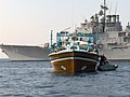 US Navy 061110-N-6397K-001 Responding to a distress call, Sailors assigned to a rescue and assistance team from the U.S. Navy guided-missile cruiser USS Anzio (CG 68), provide aid to the motor vessel SINAA, a 35-meter Iranian-f.jpg