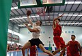 US Navy 061116-M-4217A-001 Cpl. John Badon, a U.S. Marine attached to the 31st Marine Expeditionary Unit (MEU) completes a reverse lay-up during an exhibition basketball game.jpg