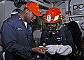 US Navy 070210-N-4649C-096 Chief Damage Controlman Enrique Jograj reviews the contents of a gas free kit to Engineman 2nd Class Jason Garcia during a main space fire drill aboard Arleigh Burke-class guided missile destroyer USS.jpg