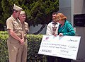 US Navy 070710-N-3436N-009 Pam Fair, San Diego Gas ^ Electric (SDG^E) vice president for customer operations, presents a $1 million check to Rear Adm. Len Hering, commander of Navy Region Southwest, and Capt. Steve Wirsching.jpg