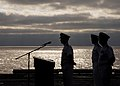 US Navy 070717-N-0916O-008 Capt. O.P. Honors, executive officer aboard USS Enterprise (CVN 65), and other participants await the arrival of the official party during a burial-at-sea ceremony aboard the nuclear-powered aircraft.jpg