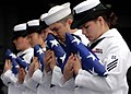 US Navy 070819-N-7981E-605 Flag bearers bow their heads in prayer during a burial at sea ceremony aboard Nimitz-class aircraft carrier USS Abraham Lincoln (CVN 72).jpg