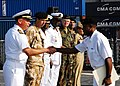 US Navy 071123-N-8933S-057 Capt. John B. Nowell Jr., Commodore of Africa Partnership Station (APS), along with the international APS staff, congratulates Ghanaian Navy Petty Officer 1st Class Bennet Botchway Obro.jpg