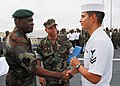 US Navy 080117-N-8933S-137 Capt. Paul Biving Nziengui, left, chief of the Gabonese National Navy, thanks Storekeeper 2nd Class Ronald Saucedo, right, for saving the life of a Gabonese civilian on Sogara Beach, Gabon.jpg