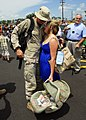 US Navy 080804-N-3857R-005 A Seabee assigned to Naval Mobile Construction Battalion (NMCB) 74 greets his family.jpg