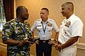 US Navy 080923-N-9818V-096 Kenyan Defense Sgt. Major, Warrant Officer 1 Ashford Miriti Ndubi talks with Master Chief Petty Officer of the Coast Guard Skip Bowen and Master Chief Petty Officer of the Navy (MCPON) Joe R. Campa Jr.jpg
