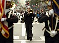US Navy 081013-N-5758H-591 Musician 2nd Class Carlton Shippee plays the trombone as he marches up 5th Avenue in New York City during the 64th Annual Columbus Day Parade.jpg