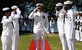 US Navy 081023-N-9758L-015 Capt. David Adler salutes as he is piped through sideboys.jpg
