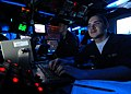 US Navy 090129-N-9950J-021 Air Traffic Controller Airman Apprentice Adam Minkel works at his desk in the amphibious air traffic control center.jpg