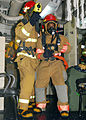 US Navy 090505-N-3215T-029 Gas Turbine Systems Technician (Mechanical) Fireman Lee Wynne, right, from Dallas, combats a simulated class alpha fire as team leader Boatswain's Mate 2nd Class Wesley Richardson, from San Angelo, Te.jpg
