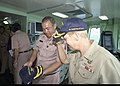US Navy 090713-N-6770T-568 Admiral Nora Tyson, Commander, Logistics Group Western Pacific, receives a Royal Thai Navy aircraft carrier HTMS Chakri Naruebet (CVH 911) command ball cap from Rear Adm. Chaiyot Sundaranaga.jpg