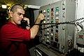 US Navy 100504-N-6604E-039 A Sailor aboard USS Dwight D. Eisenhower (CVN 69) uses a sound-powered phone to communicate with personnel several decks below.jpg