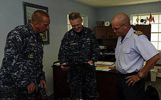 Barbados Defence Force - Image: US Navy 100824 N 9643W 390 Capt. Michael Jacobsen, center, Capt. Kurt Hedberg, left, and the commanding officer of the Barbados Defense Force look at old photos