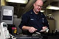 US Navy 110907-N-JD217-022 Personnel Specialist 2nd Class Frank J. Arndt counts money in the disbursing office aboard the aircraft carrier USS Geor.jpg