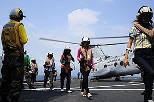 US Navy 120212-N-WV964-170 Mock non-combatant evacuation operation (NEO) participants exit a CH-46 Sea Knight helicopter aboard the forward-deploye.jpg