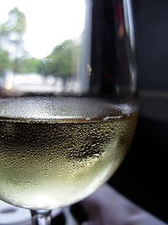 Unidentified white wine in glass