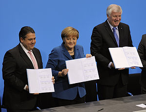 Coalition agreement - Sigmar Gabriel (SPD), Angela Merkel (CDU) and Horst Seehofer (CSU) presenting the 2013 coalition agreement for Germany's third Merkel cabinet.