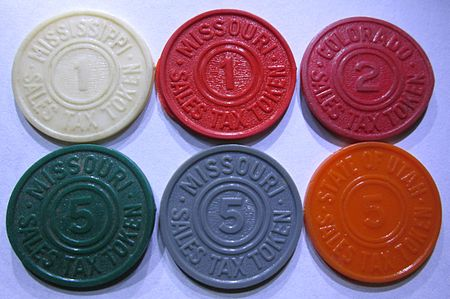 "A number of states issued colorful plastic tax tokens made in quantities running into hundreds of millions. The denominations on the token are numbers of ""mills"" (tenths of one cent). Various plastic sales tax tokens from the United States.jpg"