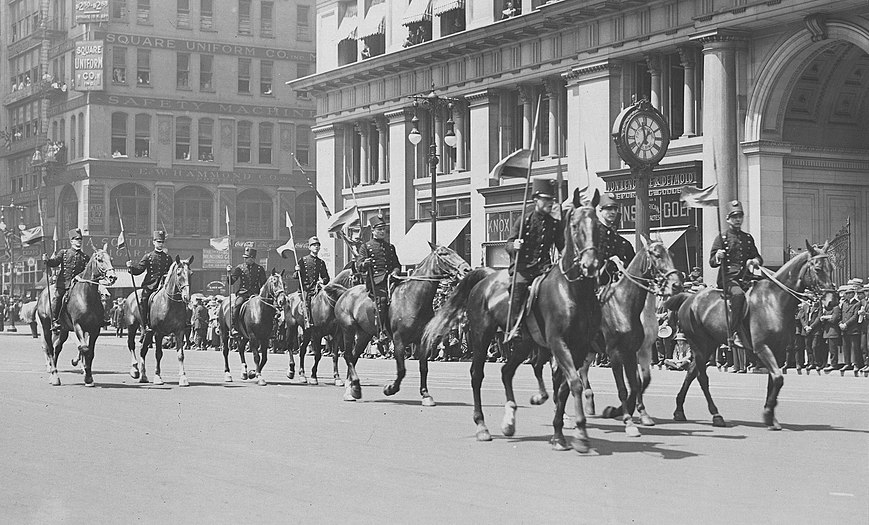 Black-and-white photograph of Venezuelan lancer cavalry marching down Fifth Avenue in New York City during its July 1918 parade