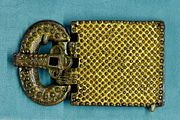 Belt buckle. Gilt and silvered bronze and glass paste, Visigothic Aquitaine, 6th century. Found in 1868 in the Visigothic necropolis of Tressan, Provence (Musée national du Moyen Âge)