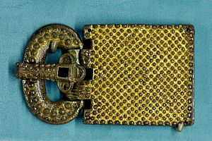 Visigoths - Belt buckle. Gilt and silvered bronze and glass paste, Visigothic Aquitaine, 6th century. Found in 1868 in the Visigothic necropolis of Tressan, Hérault, Languedoc (Musée national du Moyen Âge)