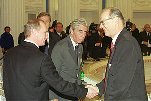 Luzius Wildhaber - Luzius Wildhaber (right) shaking the hand of Vladimir Putin