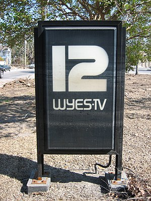 WYES-TV - Sign in front of WYES' New Orleans studio building, with visible high water lines from Katrina's earlier flooding.
