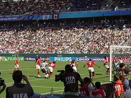 Wambach plays off a corner kick at the 2003 FIFA Women's World Cup bronze medal game against Canada. Wambach 2003.jpg