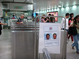 Wanted posters are visible everywhere in Singapore after his escape, such as this one at Somerset MRT Station.