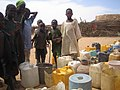 Water collecting place in Farchana refugee camp (5354335704).jpg