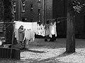Woman Hangs Laundry On (42647730).jpeg
