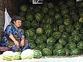 Woman Selling Watermelons out of Back of Truck - Bazaar - Andijon - Uzbekistan (7543448192).jpg