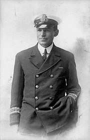 Man in dark naval uniform and wearing an officer's cap