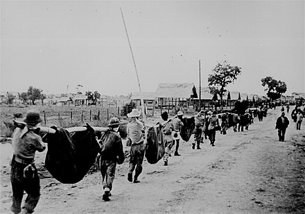 A burial detail of American and Filipino POWs killed during the Bataan Death March, 1942 Ww2 131.jpg