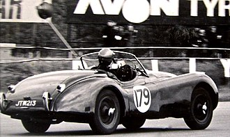 Jaguar XK120 - 1951 XK120 racing at Silverstone has a single aero screen mounted behind the removable full-width windscreen