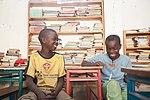 Zambian Boys Reading and Laughing (15349199369).jpg