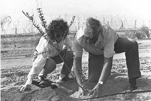Haim (Jumes) and Nili Oron plant a tree. Haim ...