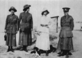 (From left) Nurse Latham, Tiddison, Dr Maude her dog Nitsa and Jo 'Kiltie' Whitehead at Mikra Bay, near Salonika, 1916.png