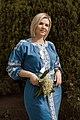 День Вишиванки. Молода україночка у вишитій синій сукні серед квітів 28.jpg
