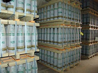 "Sulfur mustard - Pallets of 155 mm artillery shells containing ""HD"" (distilled sulfur mustard agent) at Pueblo chemical weapons storage facility. The distinctive color-coding scheme on each shell is visible"
